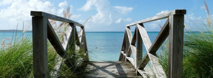 Wooden bridge to Caribbean beach